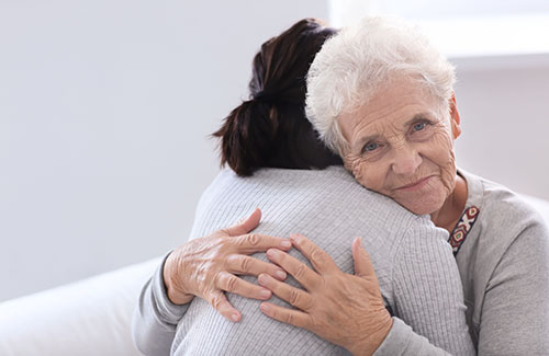 a woman hugs her daughter as she they think about clover hill